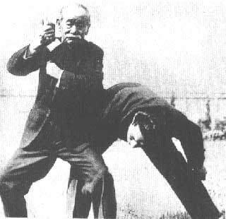 Kano demonstrates a self-defense technique.